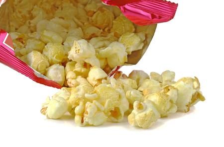 spilling: Popcorn, Spilling, Isolated on white