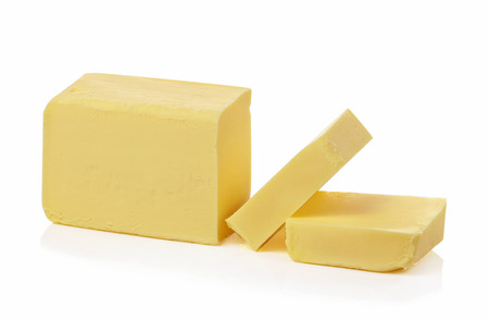binge: Stick of butter, cut, isolated on white