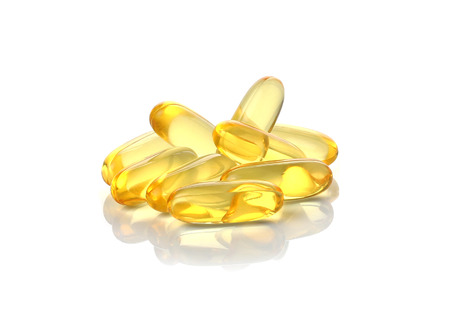 cod oil: Cod liver oil omega 3 gel capsules isolated on white background