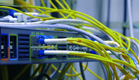 gigabit: optic fiber cables connected to data center
