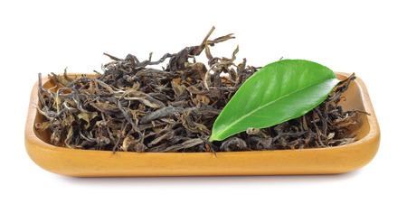 pekoe: black tea with leaf isolated in wooden on white background