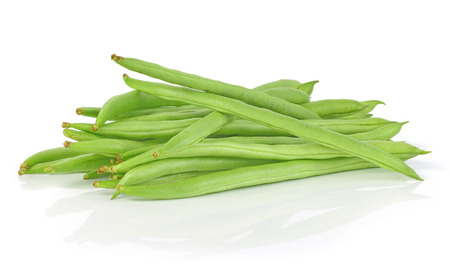 string: Pile of green french beans in isolated white background