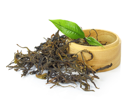 pekoe: black tea with leaf in wooden isolated on white background