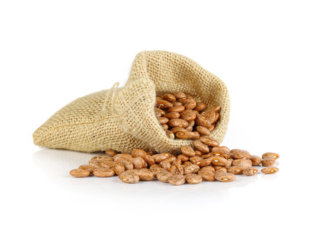 roman beans: Pinto-beans isolated in sack on white background