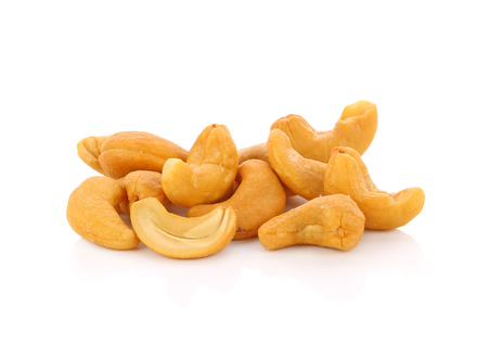 Roasted cashew nuts whith salt on white background