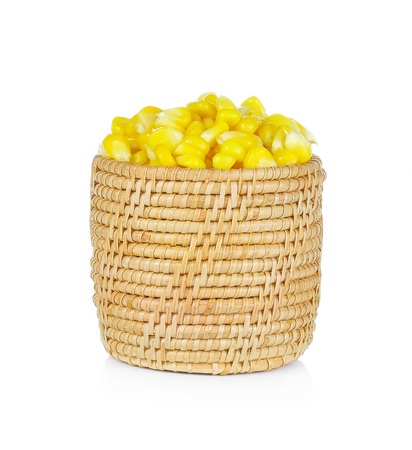 corn: Sweet whole kernel corn in basket on white background Stock Photo