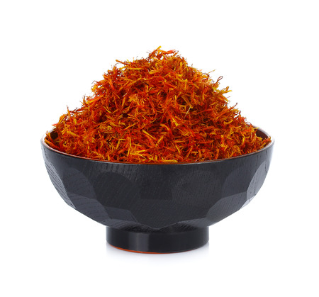 Safflower in bowl isolate  on white background Stock Photo