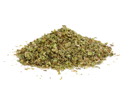 Pile of dried oregano leaves isolated on white background Imagens