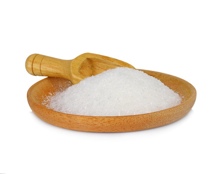 MonosodiumGlutamate (MSG or E621) on wooden plate isolated on white background. Stock Photo