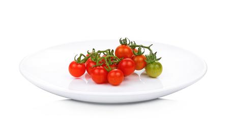 Wild tomato in white plate isolate on white background
