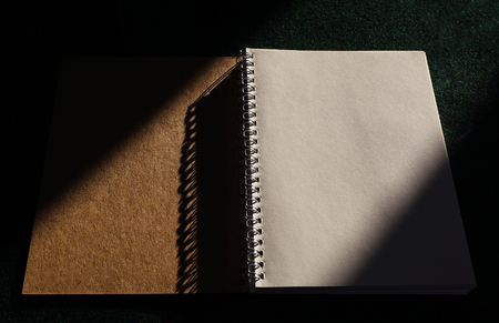 Notebook on the black office table