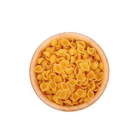 pasta in wooden bowl isolated on white background.