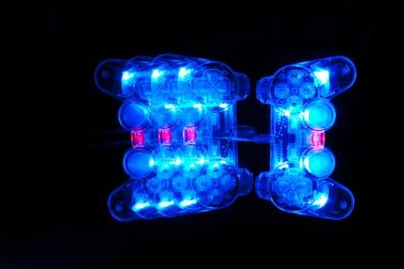 Joystrik with light blue on a black background Stock Photo