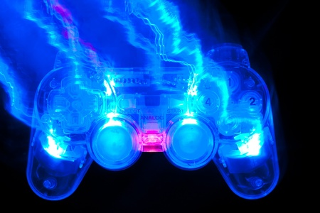 The blue game controller on a black background photo