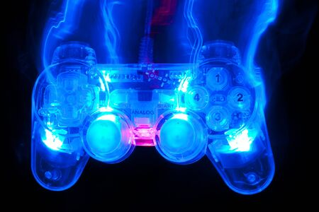 The blue game controller on a black background Stock Photo