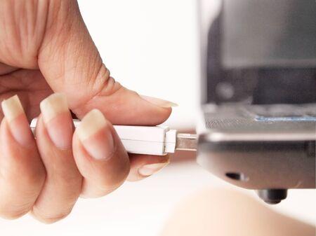 Plug the thumb drive Stock Photo
