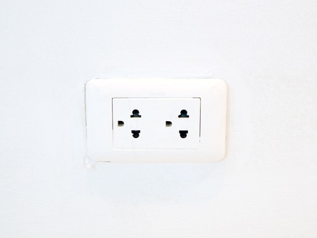 Socket on the wall white photo