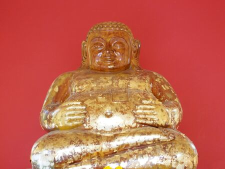 Buddha statue with a red background photo
