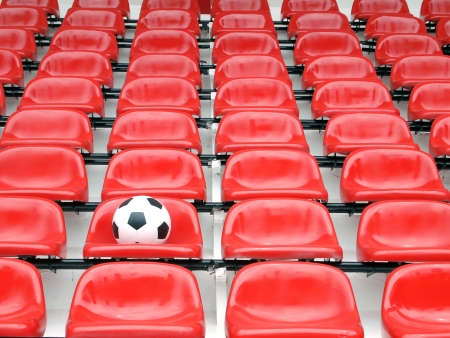 football on stadium chairs photo