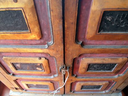 Wooden door of old barn with lock and chain photo