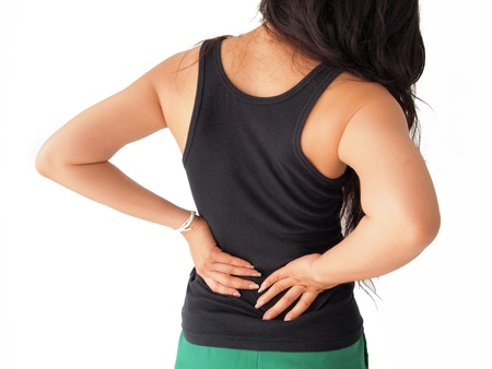 hand on hip: female has backache  Stock Photo