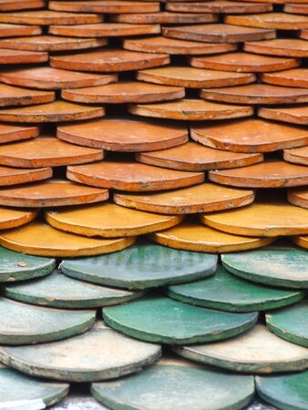 Old red brick roof tiles Stock Photo