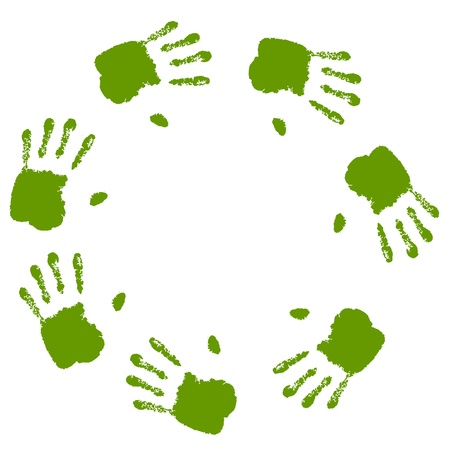 conceptual circle or spiral of green hand prints photo