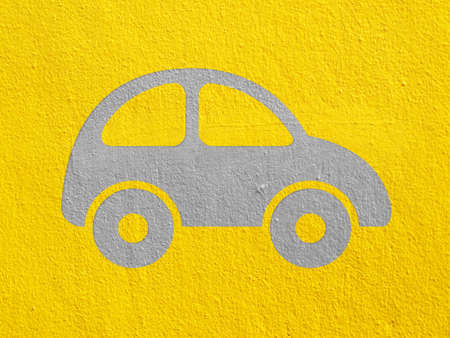 Car on  yellow cement wall photo