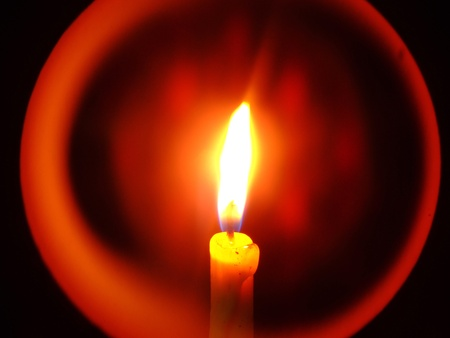 Close up of Candle with red background
