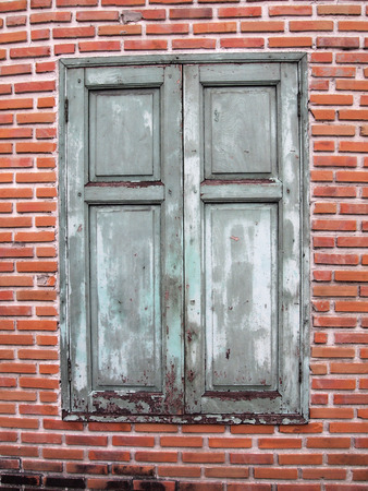 Brown wooden window on brick wall  photo