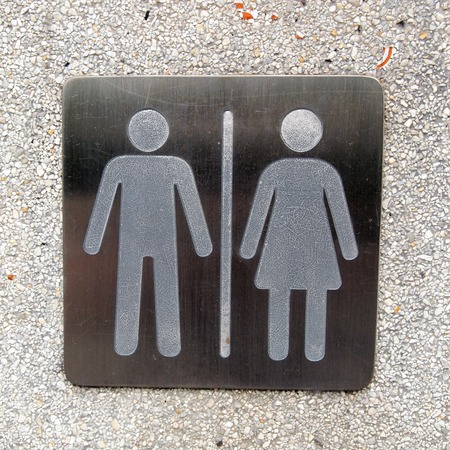 peephole: toilet plate sign on wall  Stock Photo