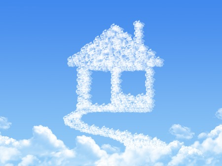 Home sign on Cloud shaped ,dream concept Standard-Bild