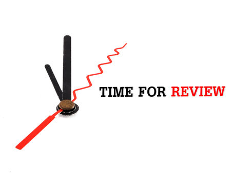 recap: time for review concept clock closeup on white background