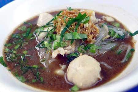 bowl of thai style beef noodle soup photo