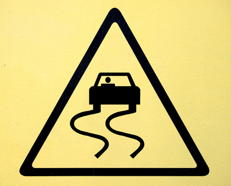 Slippery when wet road sign photo