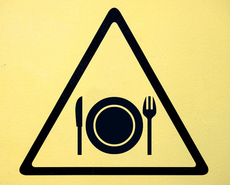 triangular road sign with fork and knife  photo