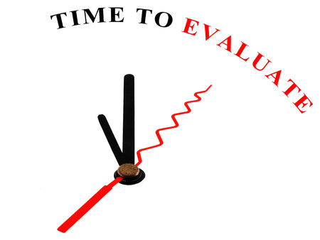 The words Time to Evaluate on an ornate white clock photo