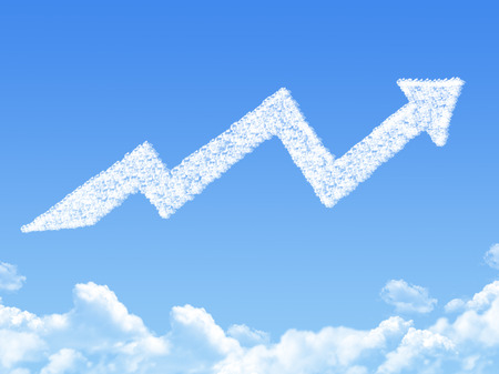 fluffy clouds: growth arrow shaped cloud Stock Photo