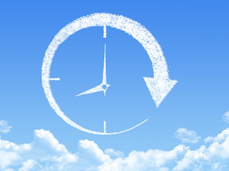 Cloud shaped as clock and time photo