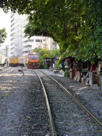 BANGKOK, THAILAND - MARCH 3: Train rides on railway in Bangkok, Thailand on March 3, 2012.