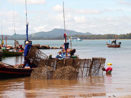 CHUMPHON THAILAND SEPTEMBER 22: Fisherman carrys net in his boat on 22 september 2012 in Chumphon Thailand.