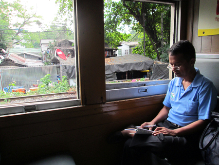 BANGKOK - NOVEMBER 17: The Unidentified men read book in train on November 17, 2012 in Bangkok, Thailand.  Editorial