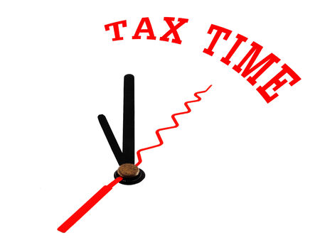 tax time concept clock closeup isolated on white with red words photo