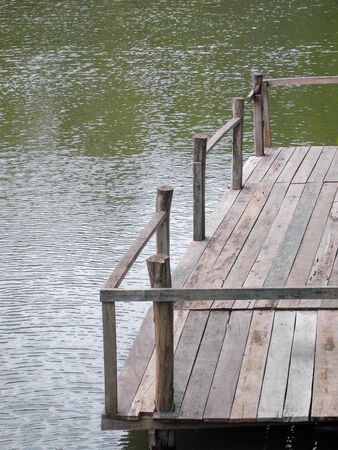 Wooden dock on the lake photo