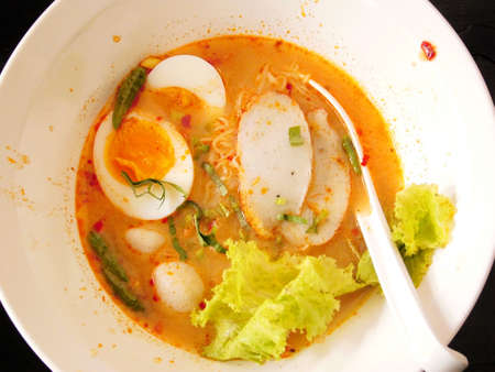 Thai noodle soup with pork ball and egg photo