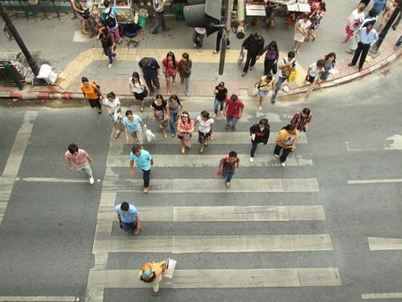 BANGKOK, THAILAND - MARCH 14: Unidentified pedestrians at Rat Prasong crossing on March 14, 2009 in Bangkok, Thailand.