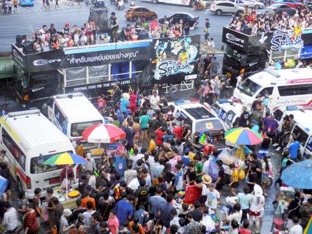 silom: BANGKOK - APRIL 13: Crowd of people celebrating the traditional Songkran New Year Festival, April 13, 2012, Silom road, Bangkok, Thailand Editorial