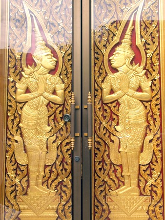 pattern in traditional Thai style art painting on door of the temple  photo