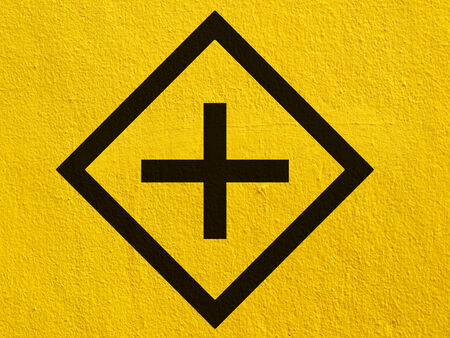 a black arrow points painted on a stucco wall outside photo
