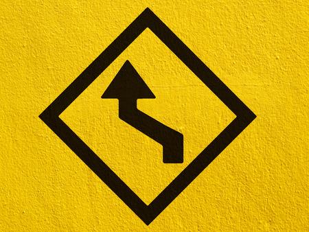 stucco wall: a black arrow points painted on a stucco wall outside